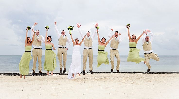 Love these long, green bridesmaid dresses! Would you call this color mint, pistachio or key lime? And a wedding party jump is always a fun photo! | Palace Resorts Weddings ®