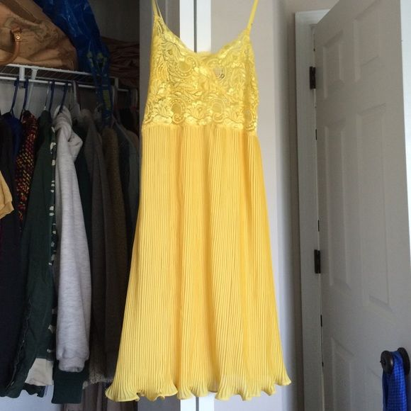 Canary yellow nightie Beautiful teddy with lady top, flared gathered skirt, and adjustable straps. It can be worn to bed or with bralette and panties showing through as a dress for the bolder dressers out there. NWOT. Urban Outfitters Intimates & Sleepwear Chemises & Slips