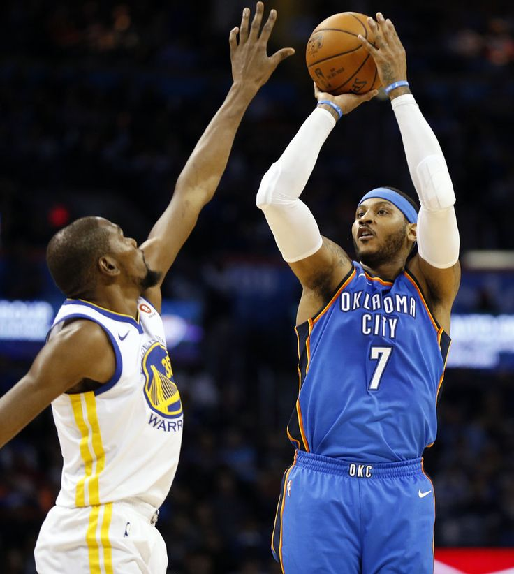 Oklahoma City's Carmelo Anthony (7) shoots against Golden State's Kevin Durant (35) during an NBA basketball game between the Oklahoma City Thunder and the Golden State Warriors at Chesapeake Energy Arena, Wednesday, Nov. 22, 2017. Photo by Nate Billings, The Oklahoman
