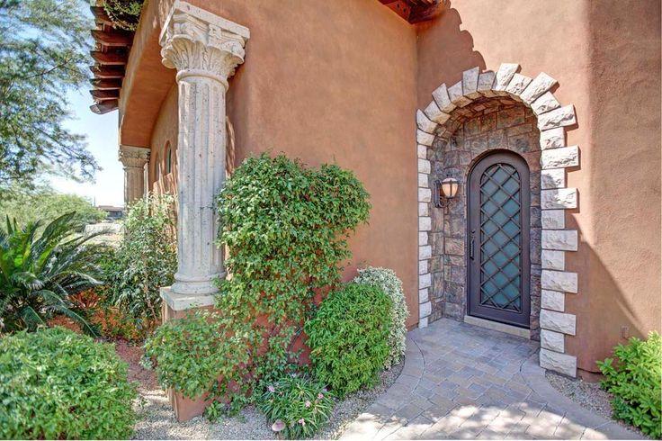 Mediterranean Front Door with exterior tile floors