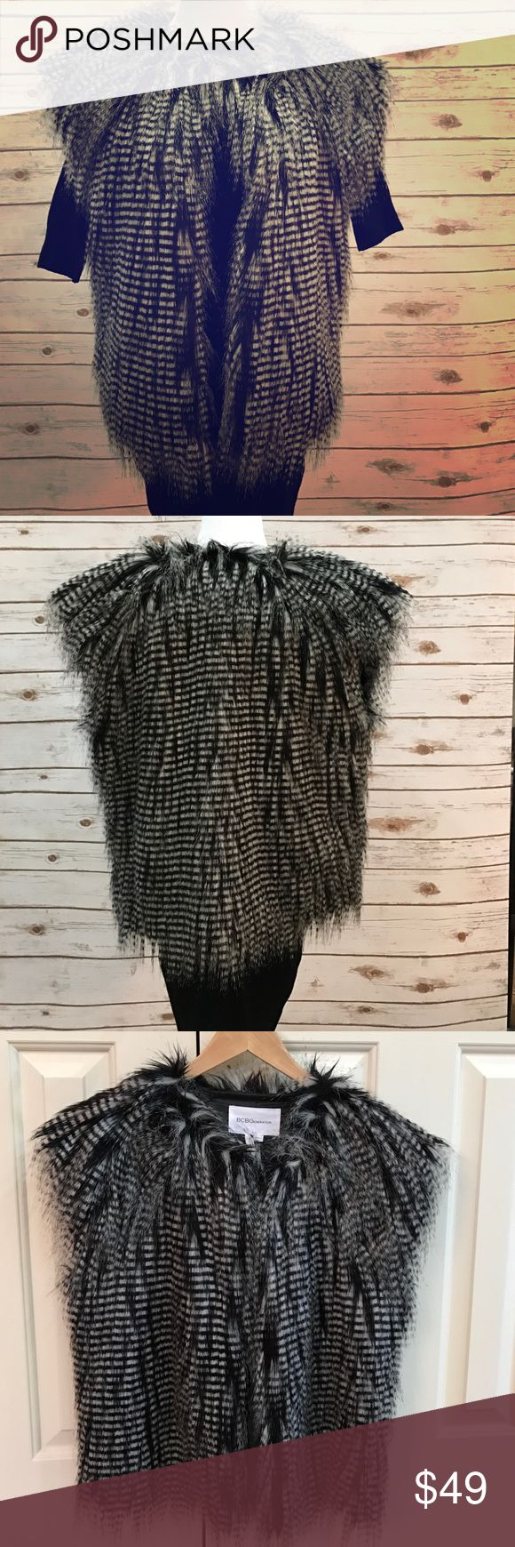 BCBG Fur Vest Beautiful faux fur vest that creates an exotic feather look. Looks hot with all black but versatile with all colors and looks. Never worn, no tags but brand new. BCBGeneration Jackets & Coats Vests