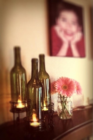 Wine bottle candle holders. Clever.