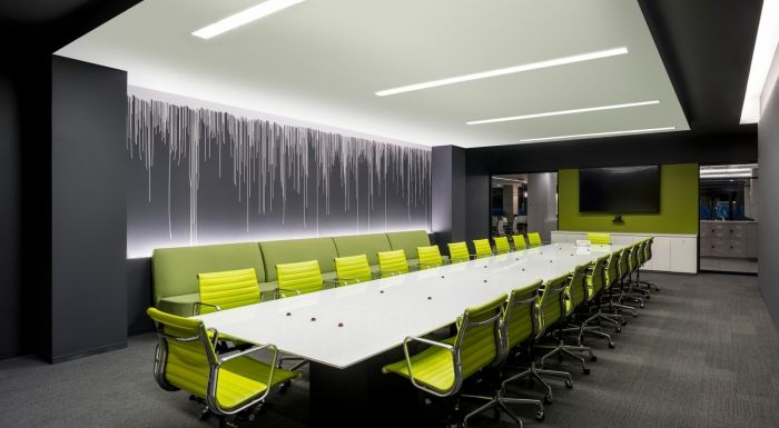 For the large conference room - the chairs are the statement, the bench in the back is nice instead of another layer of chairs, and the media wall accent color highlights the furniture. Simple and clean.