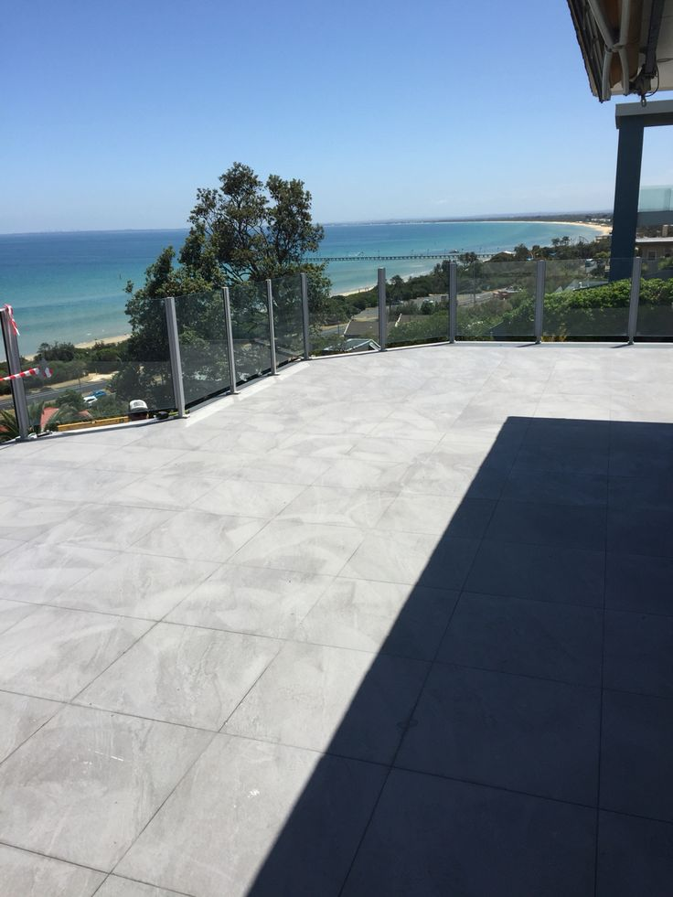60 meter balcony overlooking Port Phillip Bay, tiled in 600x600 charcoal porcelain