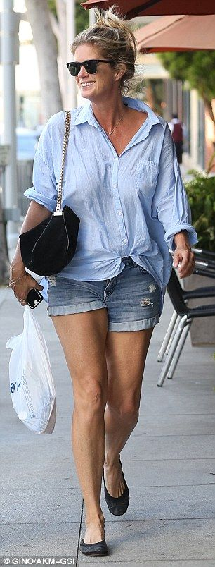 On trend: Hunter teamed her partially unbuttoned blouse with ripped Daisy Dukes, showcasin...