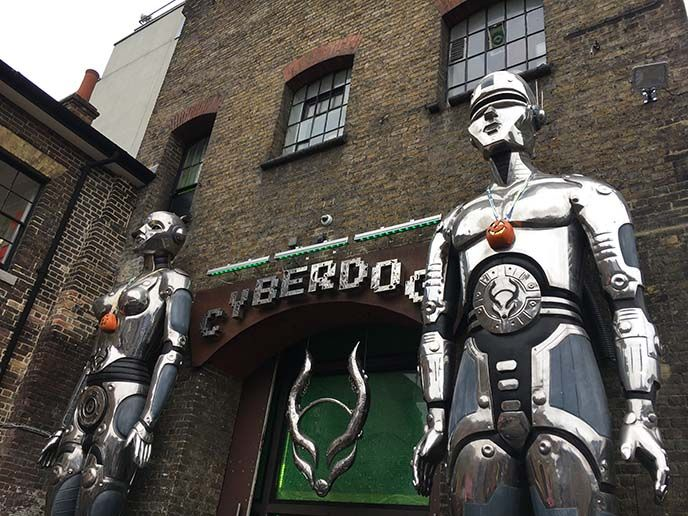 cyberdog entrance, giant robots, cyber dog logo, silver mecha bots  rave robots, london uk weird underground strange bizarre travel, camdenlock goth alternative punk shopping and travel guide, heavy metal. more at http://www.lacarmina.com/blog/2017/11/gothic-punk-shopping-guide-london-camden-shoreditch/