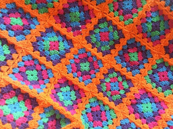 Crochet blanket, granny square, orange. Gehaakte sprei, granny square, oranje.