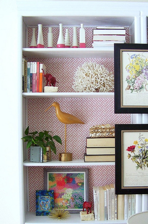 Love the wallpaper in the back. The elephant bookends are spray painted figurines super glued to flat rocks!