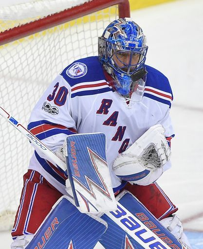 New York Rangers goalie Henrik Lundqvist (30), of Sweden, watches the puck during the third period of the team's NHL hockey game against the Washington Capitals, Wednesday, April 5, 2017, in Washington. The Capitals won 2-0. (AP Photo/Nick Wass)