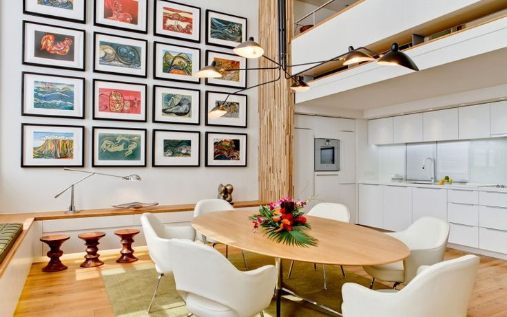I like the display of several artworks in a big wall, and like the wood column made of small pieces of wood. Very Gestalt! Design for Living by Daniel Hopwood.