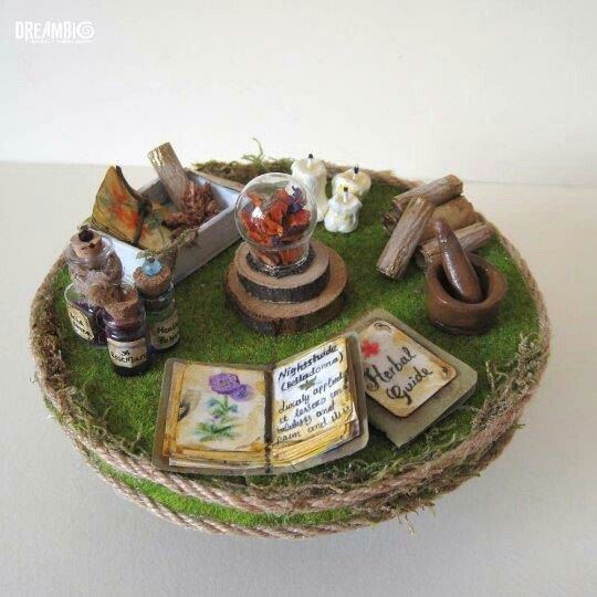 Dollhouse miniature table with herbs and healling potions. Witch table