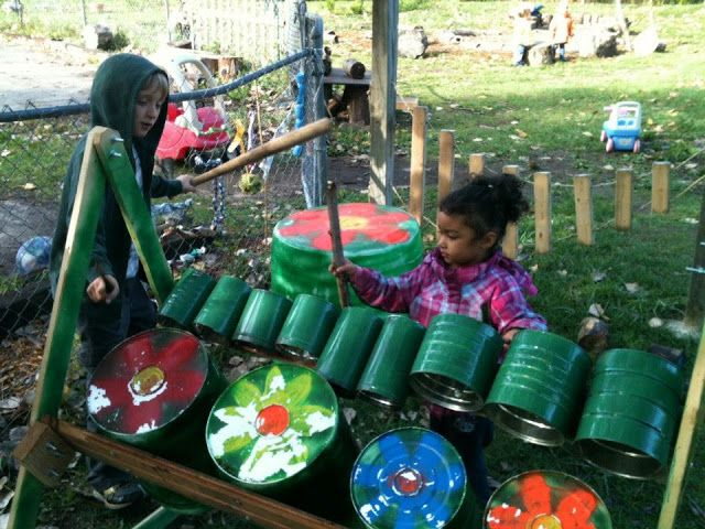 """let the children play shares Green Apple Garden Preschool's music area - they have attached different sized tins to a simple frame ("""",)"""