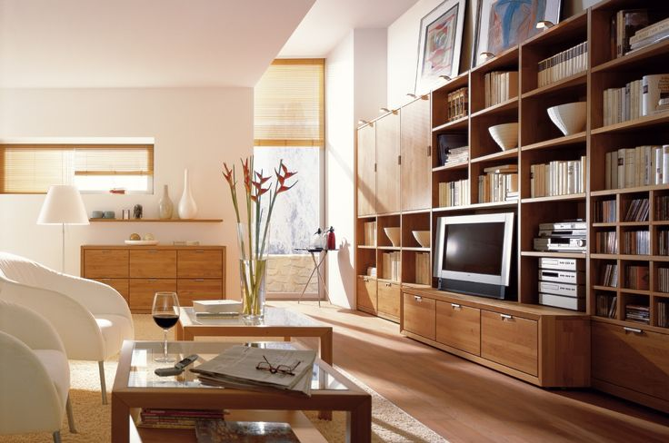 http://www.milleuno.com/elegant-wooden-finish-wall-unit-combinations-from-hulsta/square-clear-glass-table_light-glass-lamps_dark-brown-corner-wooden-bookshelf_striped-minimalist-wooden-drawer_glass-floor-lamp_crystal-vase-flower-place-card-holders/