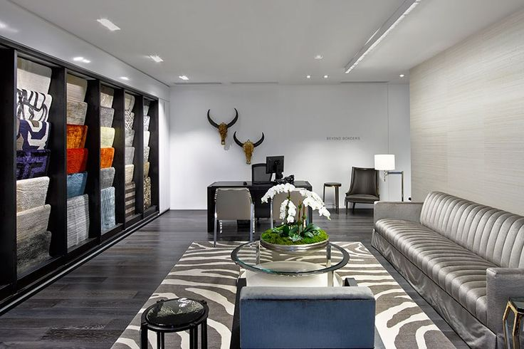 Holly Hunt's Rugs are displayed along one wall, while hand-carved water buffalo skulls from Borneo decorate another.