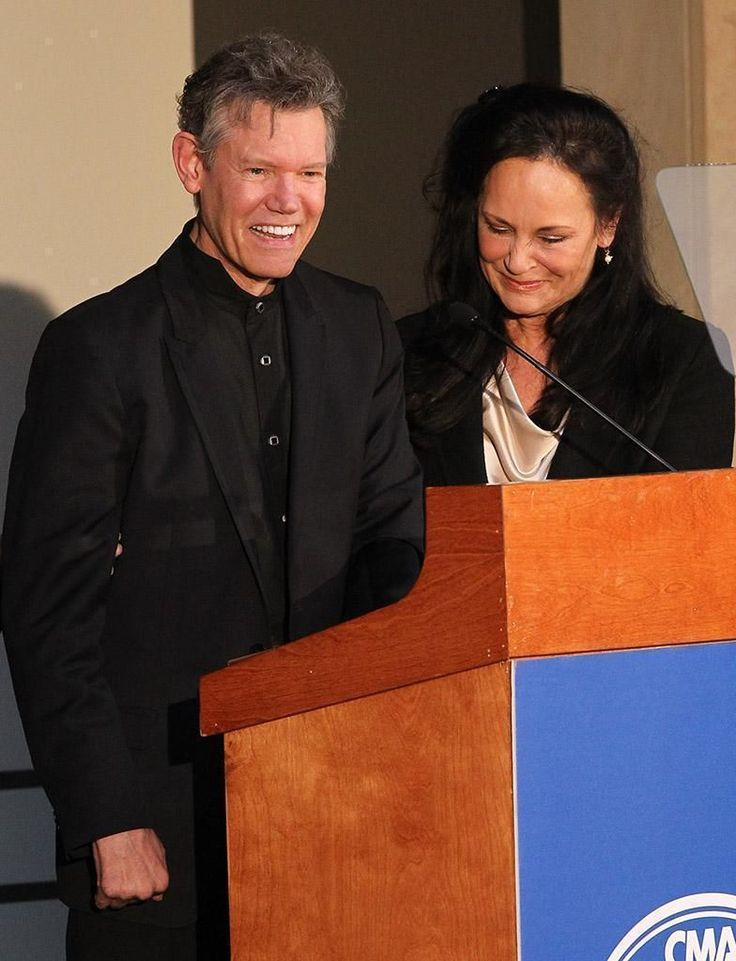 "A massive stroke in 2013 left Randy Travis with a vocabulary limited mostly these days to ""yes"" and ""no."" But on Tuesday, he haltingly coaxed out two more words – ""thank you"" – as he accepted country music's highest honor: a place in the Country Music Hall of Fame.  The poignant moment capped the announcement"