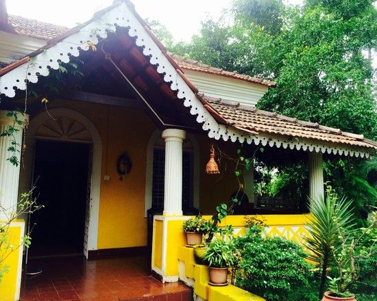 Porch with red oxide flooring in a traditional indian for Architecture design for home in goa