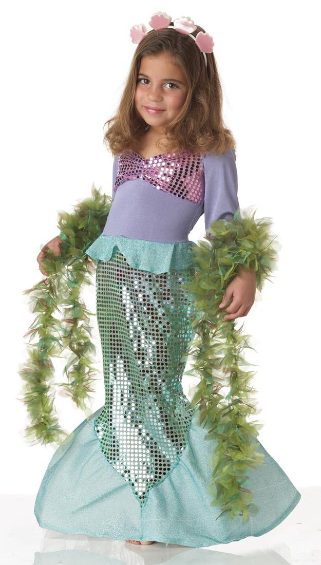 Make a splash in this adorable Lil' Mermaid Toddler / Child costume, with a lavender and pink sequined bodice, sparkling turquoise tail, and sprightly seashell headband. Imagine riding the waves along