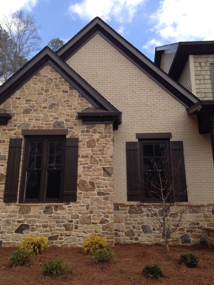 Painted bricks bricks and stones on pinterest for Painted brick houses with siding