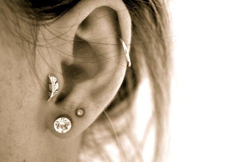 Tragus piercing. Oh my gosh. I want this feather stud after mine will heal.