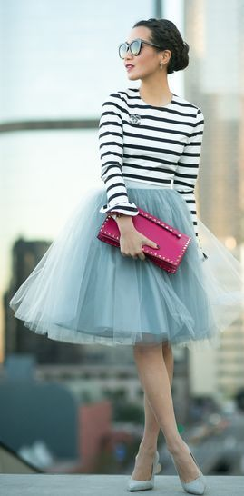 Escapade outfit: long sleeves striped top with grey tulle skirt, matching shoes and a neon clutch.
