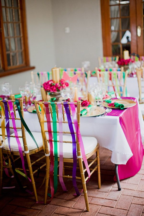 colorful chair streamers <3  http://www.rocknrollbride.com/2012/03/a-multi-coloured-south-african-wedding-mark-manilla/