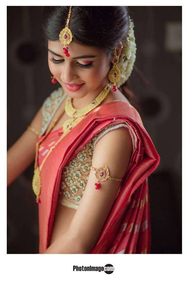 South Indian bride. Temple jewelry. Jhumkis.Pink silk kanchipuram sari.Braid with fresh flowers. Tamil bride. Telugu bride. Kannada bride. Hindu bride. Malayalee bride.Kerala bride.