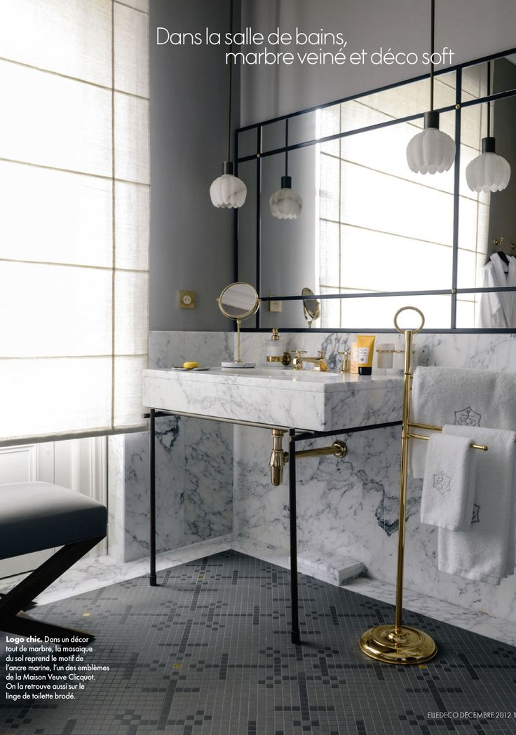 gold fixtures in bathroom contrast the black  u0026 white of marble  pendant lights  via elle decor