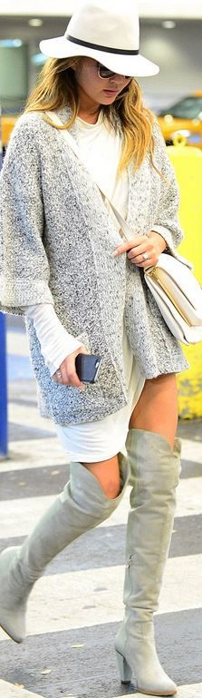 Who made Chrissy Teigen's hat, handbag, and gray cardigan sweater? Sweater – Isabel Marant  Hat – Rag & Bone  Purse – Celine