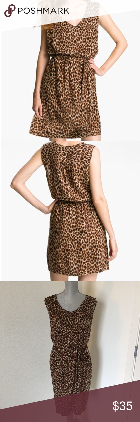 Lucky Cheetah Dress - Size XL Lucky Brand 'Brinkley-Cheetah' Dress. Size XL. Slips over head (no zipper/buttons), blousy V-neck bodice and tie belt wrapping the waist. The waist is elastic (Note: first 2 pictures are from advertisement, other pics are of dress for sale). Lucky Brand Dresses