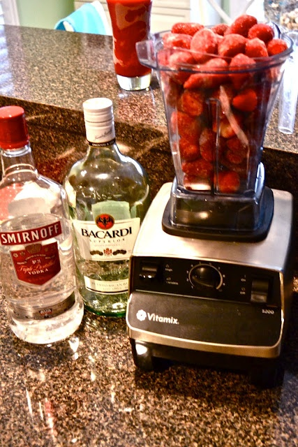 Sassy Skinny Strawberry Daiquiri   Ingredients:        6 cups frozen strawberries (or just fill your blender up to the top)      6 ounces clear rum (adjust based on your affinity for alcohol)      6 ounces vodka (adjust based on your affinity for alcohol)       3 packets of Stevia      juice of 1 large lime      lime slices for garnish