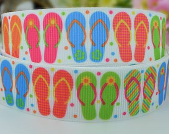 Delightful 100% polyester grosgrain ribbon with bright multi coloured flip flops on a white background with small colourful spots