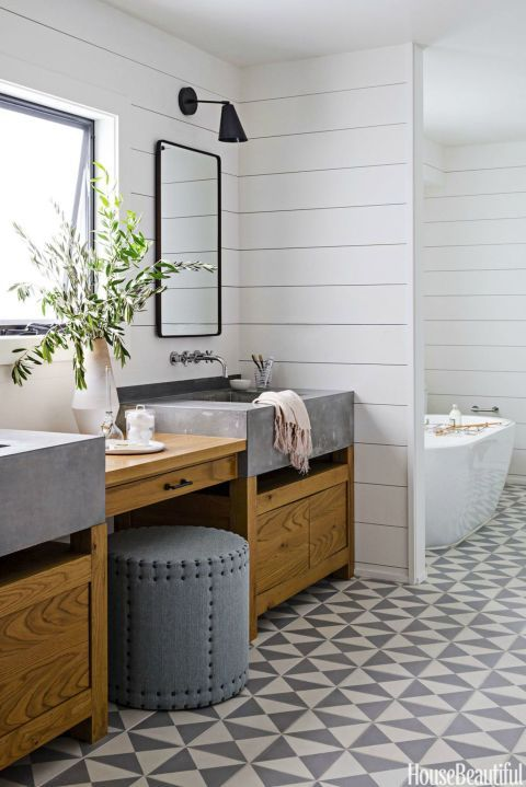 """CEMENT STYLE – Cement floor tiles pick up the gray and """"add just the right amount of pattern,"""" says designer Daleet Spector of an understated bath. """"And they're cool and fresh on bare feet. The room is luxurious but in a very modern, understated way."""" Click through for more bathroom tiles ideas."""