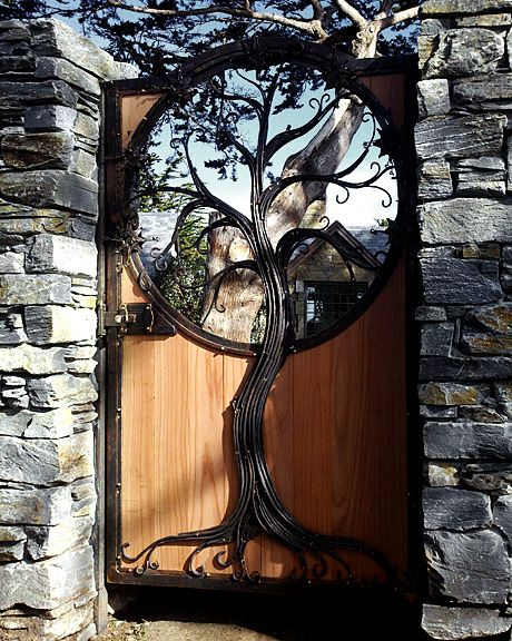 Tree of Gondor forged and fabricated bronze with natural patina, redwood, stainless steel hidden structural elements glass by others