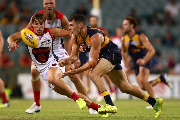 Luke Shuey Photos Photos - Luke Shuey of the Eagles handballs during the JLT Community Series AFL match between the West Coast Eagles and the Melbourne Demons at Domain Stadium on March 9, 2017 in Perth, Australia. - West Coast v Melbourne - 2017 JLT Community Series