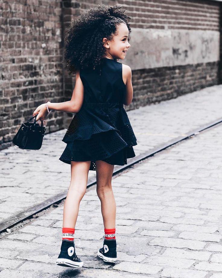 Kid twirling in her mini black dress.