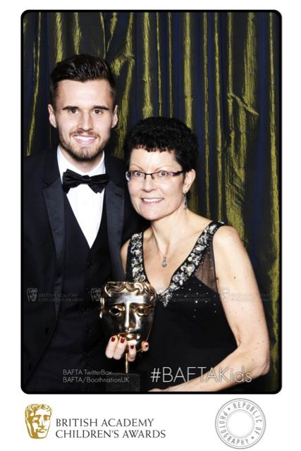 Arsenal footballer Carl Jenkinson poses with BAFTA winner Kay Benbow who picked up the Channel of the Year BAFTA, awarded to CBeebies.