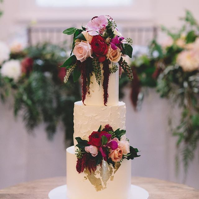 3 tier wedding cake by Miss ladybird cakes. Gold Leaf detail and flowers by Botanics, at Abbotsford Convent wedding by Vanessa Norris Photography.