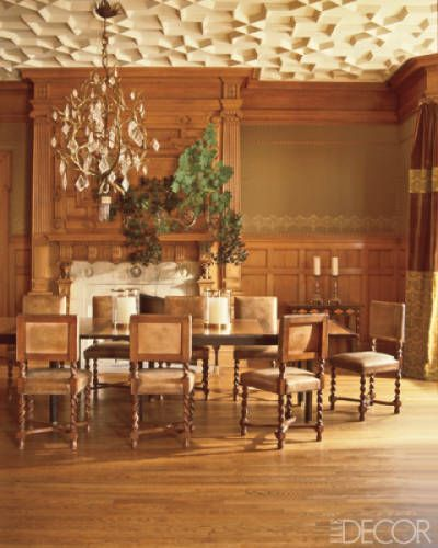 With this room, it's easy to become inspired from the wood paneling on the walls, the regal mantel above the fireplace to the geometric patterned ceiling. Every inch of this dining room is a masterpiece of luxurious #trimwork! #inspiration #interiordesign #trim #interiorfinishings #moulding