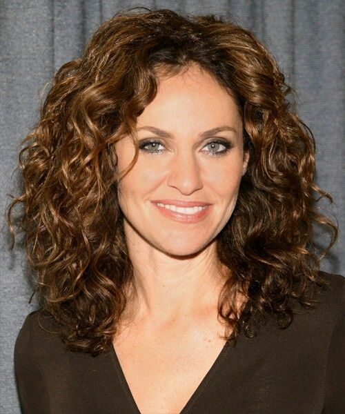 Medium Curly Hair. Her hair is GORGEOUS!!