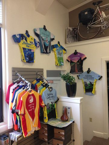 check out this cycling shop 39 s jersey display we love it hang your cycling jersey on the wall. Black Bedroom Furniture Sets. Home Design Ideas