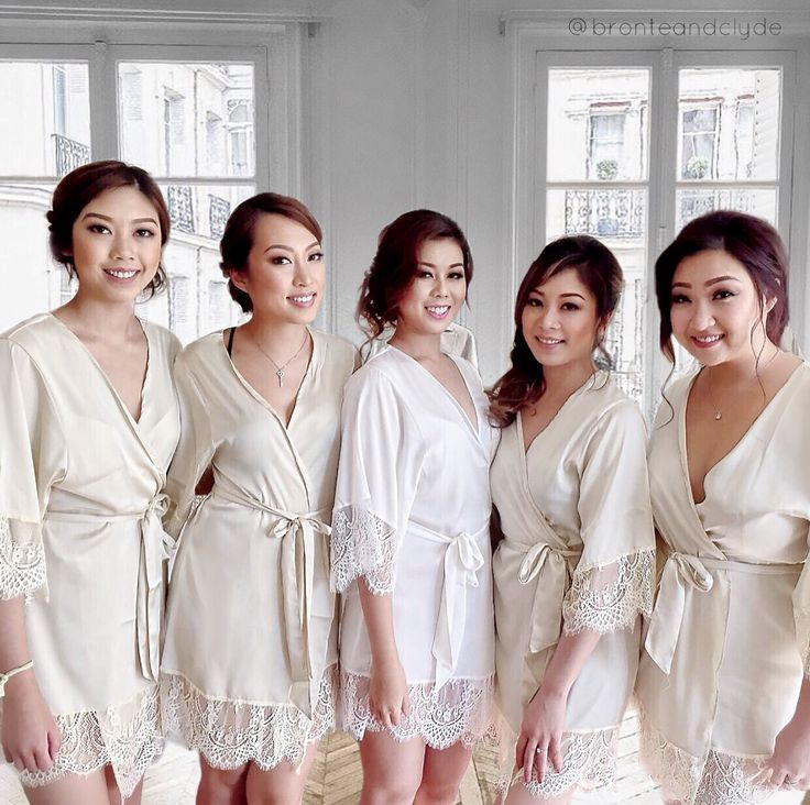 Designed by Bronte & Clyde. Pretty bride and her loyal squad in lace trim silk robes, getting ready for a gorgeous wedding