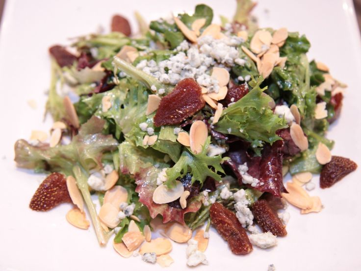Field Greens with dried strawberries. crumbled blue cheese, toasted almonds, sherry vinaigrette