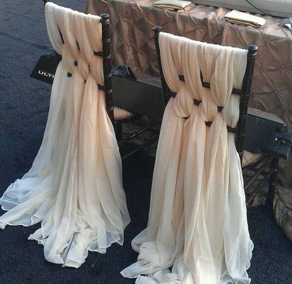 Pretty chairs!  An easy way to pretty up ladder back chairs. Would look great at a wedding too.