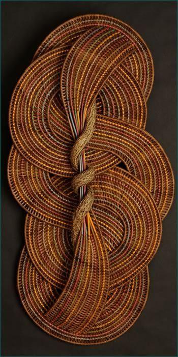 Tina Puckett, master basket weaver     Circles and Curves style wall hanging