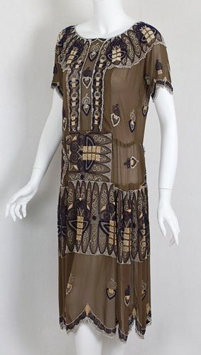 Beaded silk flapper dress, circa 1924, brown silk crepe decorated with seed beads in variegated shades of melon, tan, ivory, and blue.