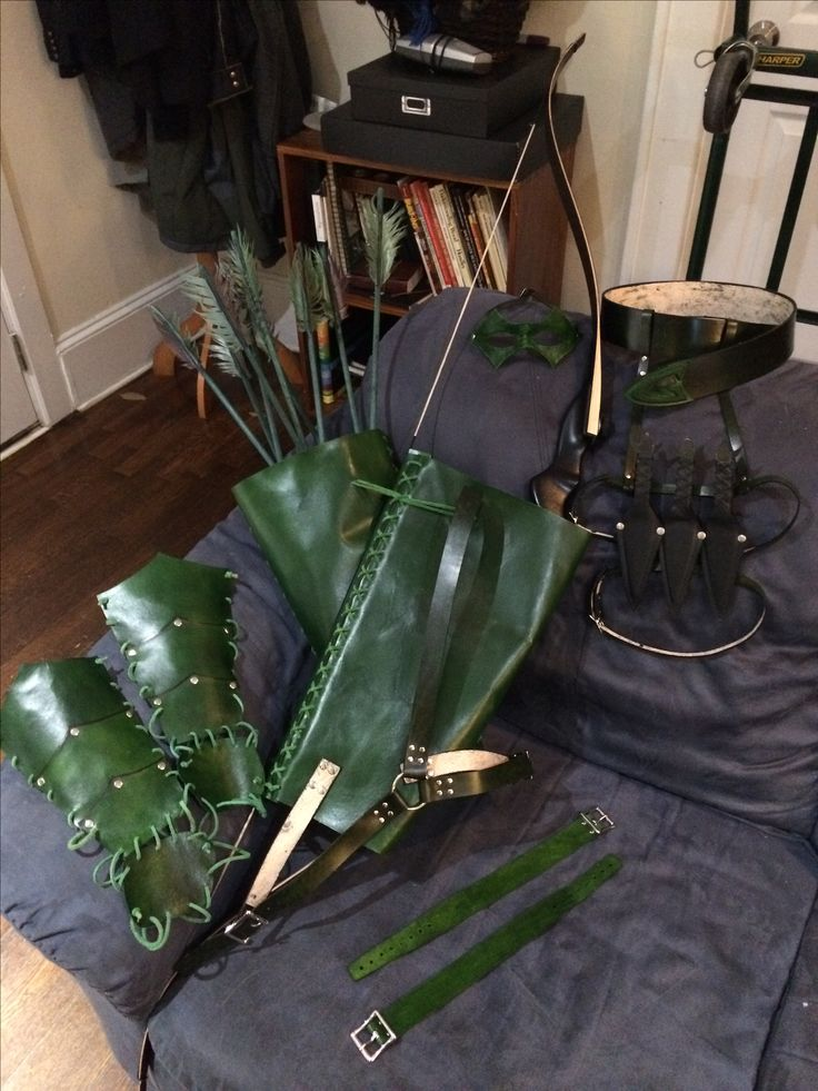 Green arrow leather gear. Bracers, quiver/bow holster, mask, belt, throwing knives leg harness, arm bands.
