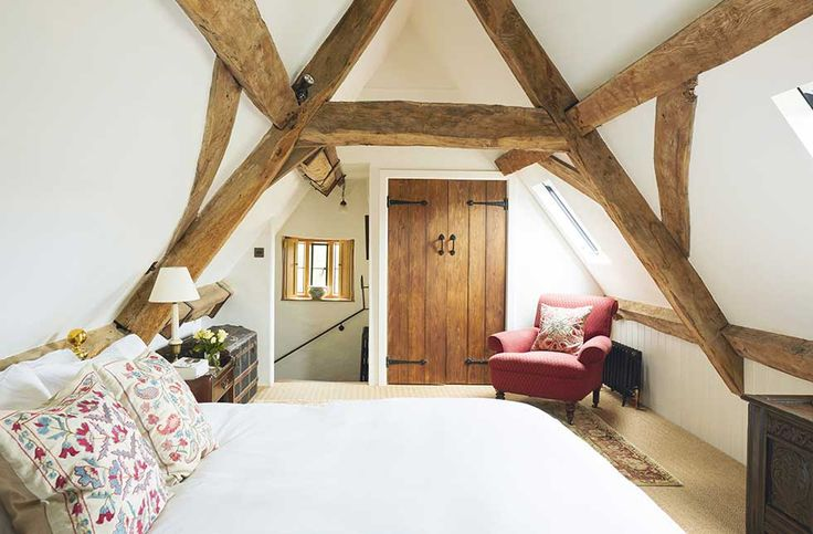a bedroom in loft space with exposed beams I'm about to rent a new house and all I want is my bedroom to look like this but it's just not gonna happen  I'm in love...