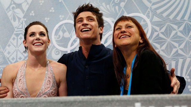 Silver medallists Tessa Virtue and Scott Moir wait for their marks in the Kiss and Cry zone