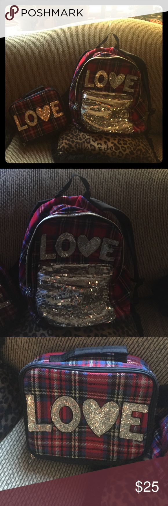 Justice for girls backpack and matching lunch box This is a plaid and Sequence justice backpack with matching lunch box. Used only one school year. Justice Bags Backpacks