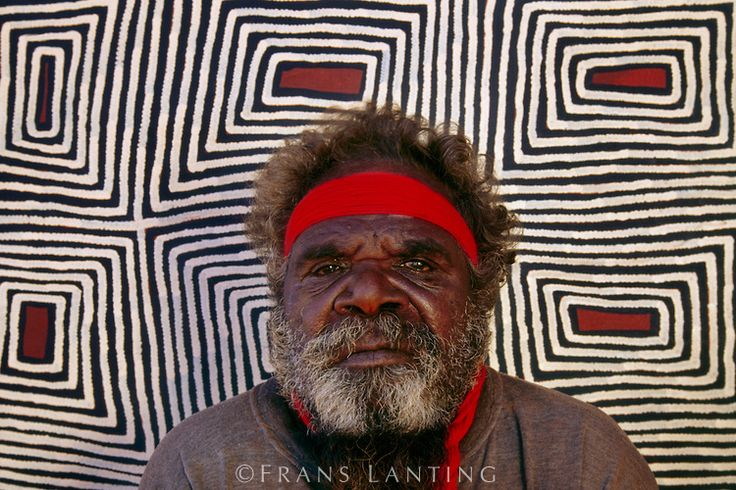 Aboriginal artist, Ronnie Tjampitjinpa, with his work, Central Desert, Australia. Photo by Frans Lanting.